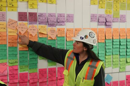 Simone going over the details of a recent construction pull-plan.